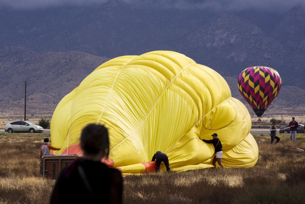 Crew members work to secure a hot air balloon after landing, October 4, 2015. REUTERS/Lucas Jackson