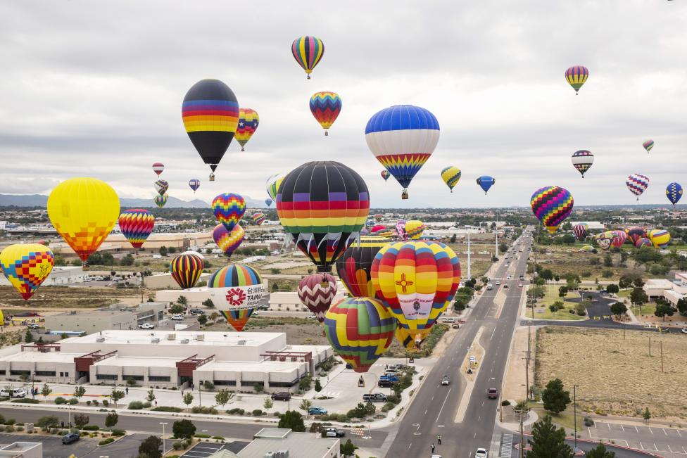 Hot air balloons drift through the sky, October 4, 2015. REUTERS/Lucas Jackson