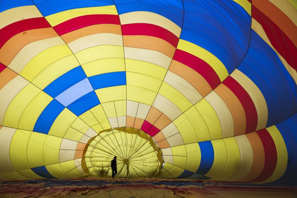 A crew member prepares a hot air balloon for take off, October 4, 2015. REUTERS/Lucas Jackson